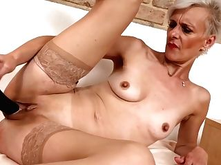 Lusty, Blonde Cougar Is Playing With Her Tits And Puss, While We Get To Observe Her